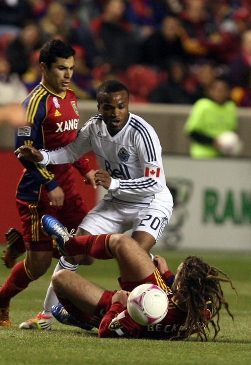 Kim Raff | The Salt Lake Tribune Real Salt Lake midfielder Kyle Beckerman (5) struggles on the ground as Vancouver FC forward Dane Richards (20) tries to gain possession of the ball during a game at Rio Tinto Stadium in Sandy, Utah on October 27, 2012.