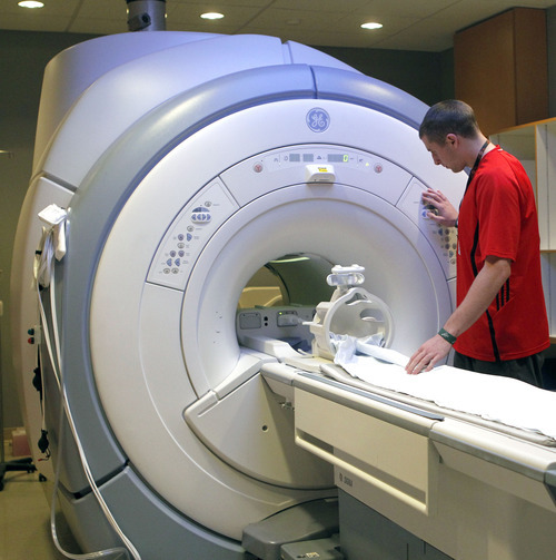 Al Hartmann  |  The Salt Lake Tribune Will Fahrenbach, an MRI technician at Intermountain Helathcare prepares a machine for a patient. MRI systems are dependent on helium. Although the nation is experiencing a helium shortage, a spokesman for Intermountain Healthcare says hospital supplies are adequate.