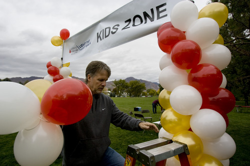 Kim Raff | The Salt Lake Tribune Steve Nielsen, owner of Balloon Bonanza, sets up columns of air-filled balloons he now uses more of because of the national shortage of helium, before the Leukemia and Lymphoma Society's Light the Night Walk at Sugarhouse Park in Salt Lake City, Utah on October 13, 2012.