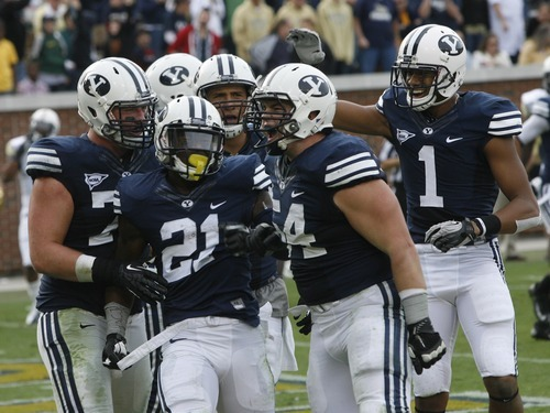Rick Egan  | The Salt Lake Tribune   THe BYU offense celebrates with Cougar running back Jamaal Williams (21) after he scored a touchdown, in football action, BYU vs Georgia Tech, at Bobby Dodd Stadium in Atlanta, Saturday, October 27, 2012