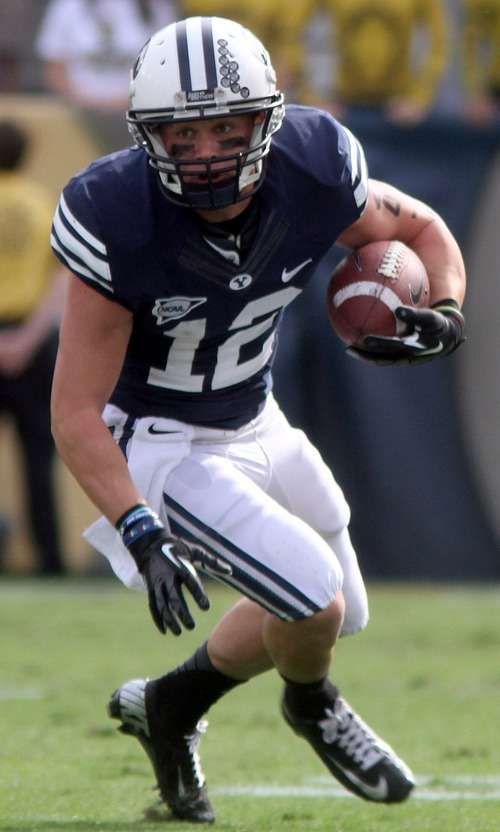 Rick Egan  | The Salt Lake Tribune   Brigham Young Cougars wide receiver JD Falslev (12) runs with the ball, in football action, BYU vs Georgia Tech, at Bobby Dodd Stadium in Atlanta, Saturday, October 27, 2012