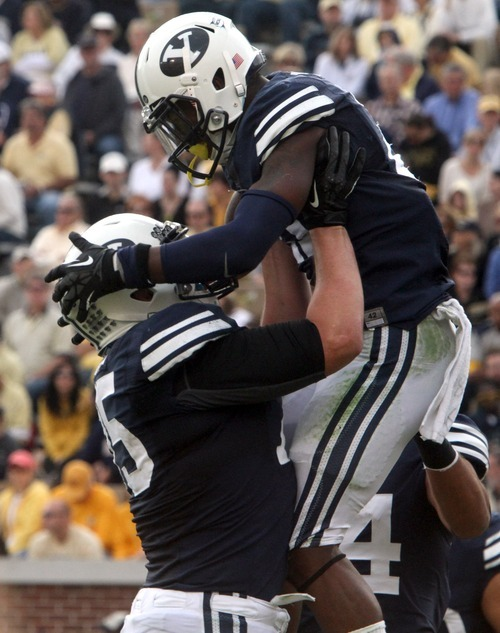 Rick Egan  | The Salt Lake Tribune   Brigham Young Cougars offensive linesman Braden Brown (75) lifts Brigham Young Cougars running back Jamaal Williams (21) up into the air, after Williams scored for BYU in game action against Georgia Tech, at Bobby Dodd Stadium in Atlanta, Saturday, October 27, 2012