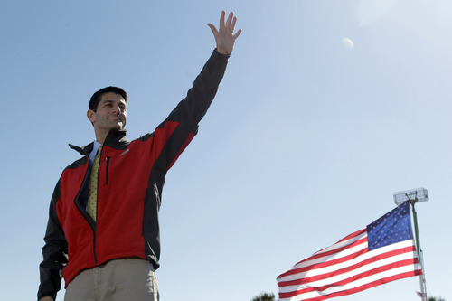 Republican vice presidential candidate, Rep. Paul Ryan, R-Wis., waves at supporters during a campaign event, Monday, Oct. 29, 2012 in Fernandina Beach, Fla.  (AP Photo/Mary Altaffer)