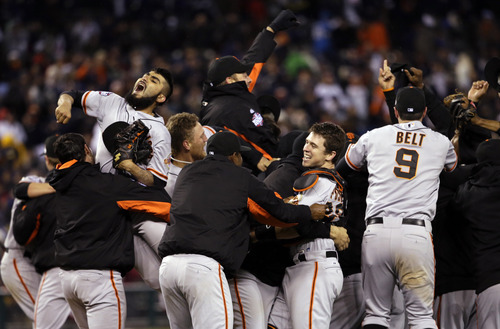 The San Francisco Giants celebrate after winning Game 4 of baseball's World Series against the Detroit Tigers Sunday, Oct. 28, 2012, in Detroit. The Giants won 4-3 to win the series. (AP Photo/David J. Phillip)
