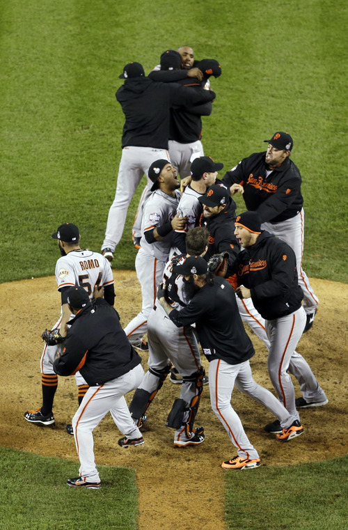 San Francisco Giants celebrate after the Giants defeated the Detroit Tigers, 4-3, in Game 4 of baseball's World Series  Sunday, Oct. 28, 2012, in Detroit. The Giants won the World  Series 4-0.  (AP Photo/Tim Donnelly)