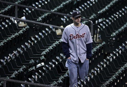 A Detroit Tigers fan leaves his seat after the Giants defeated the Detroit Tigers, 4-3, in Game 4 of baseball's World Series  Sunday, Oct. 28, 2012, in Detroit. The Giants won the World  Series 4-0. (AP Photo/Charlie Riedel)
