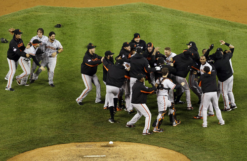 The San Francisco Giants celebrate after winning Game 4 of baseball's World Series against the Detroit Tigers Sunday, Oct. 28, 2012, in Detroit. The Giants won 4-3 to win the series. (AP Photo/Tim Donnelly)