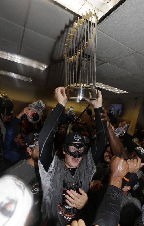 San Francisco Giants' Matt Cain holds up the Commissioner's Trophy after Game 4 of baseball's World Series against the Detroit Tigers Monday, Oct. 29, 2012, in Detroit. The Giants won the game, 4-3, to win the series. (AP Photo/David J. Phillip)