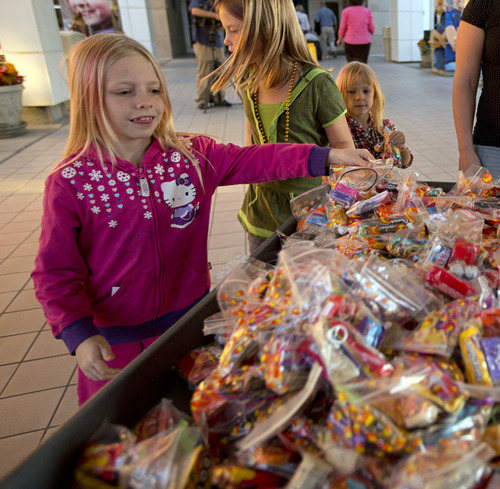 Lennie Mahler  |  The Salt Lake Tribune Kassie Aupperle and other Girl Scouts prepare to wheel in a cart full of candy to children at Primary Children's Medical Center on Tuesday, Oct. 30, 2012. Following complications and multiple hospitalizations from a hearing aid implant earlier this year, Kassie had the idea to deliver candy to hospitalized kids who wouldn't be able to Trick-or-Treat on Halloween. Cassie organized her Girl Scout troop, 2382, and troop 2385 to deliver over 300 candy packs to the hospital.