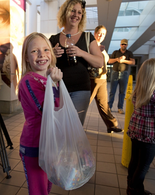 Lennie Mahler  |  The Salt Lake Tribune Kassie Aupperle holds a bag full of candy to deliver to children at Primary Children's Medical Center on Tuesday, Oct. 30, 2012. Following complications and multiple hospitalizations from a hearing aid implant earlier this year, Kassie had the idea to deliver candy to hospitalized kids who wouldn't be able to Trick-or-Treat on Halloween. Cassie organized her Girl Scout troop, 2382, and troop 2385 to deliver over 300 candy packs to the hospital.