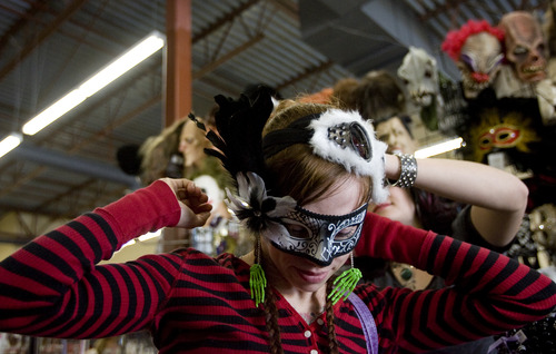Kim Raff   The Salt Lake Tribune Tacara Detevis tries on a face mastk at Mask Costumes in Taylorsville on Oct. 25, 2012.
