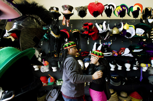 Kim Raff   The Salt Lake Tribune (left) Manuel Hernandez and Lizeth Leyva try on Rastafarian hats at Mask Costumes in Taylorsville on Oct. 25, 2012.