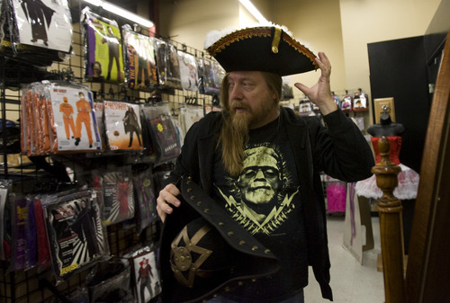 Kim Raff   The Salt Lake Tribune Chris Hanson tries on a pirate hat at Mask Costumes in Taylorsville on Oct. 25, 2012.