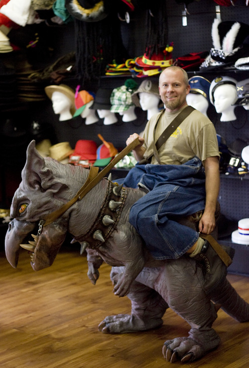 Kim Raff   The Salt Lake Tribune Owner Ryan Heugly wears a ridable dragon costume at his store Mask Costumes in Taylorsville on Oct. 25, 2012.