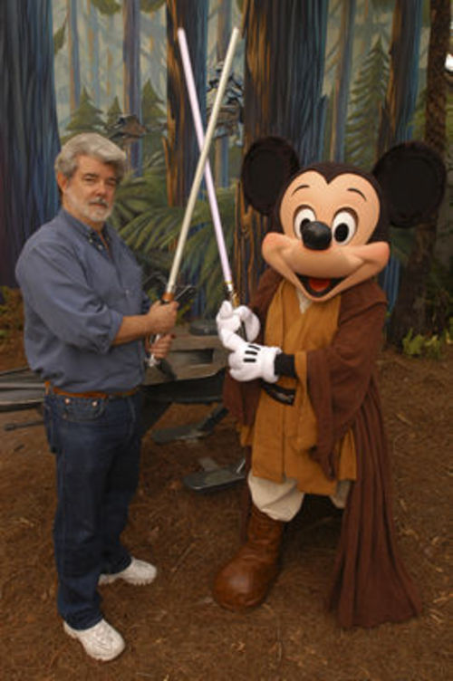 George Lucas poses with Mickey Mouse dressed in Jedi gear for the 2011 re-opening of the Star Tours attraction at Disney's Hollywood Studios in Orlando, Florida. Courtesy photo.