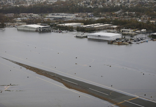 A runway at the Teterboro Airport is flooded in the wake of superstorm Sandy on Tuesday, Oct. 30, 2012, in New York. (AP Photo/Mike Groll)