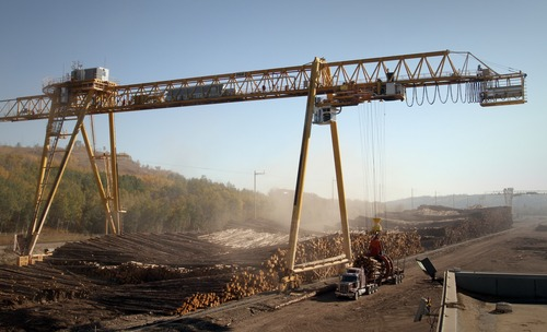 Rick Egan  |  The Salt Lake Tribune   Logs are unloaded at Weyerhaeuser's Grande Prairie mill, in the Peace Region of northern Alberta Canada, Friday, September 21, 2012.