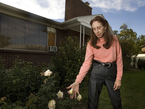 Paul Fraughton | The Salt Lake Tribune Pam Williams would like to dig up and transplant the rose bushes from around the house where she grew up, behind her, to ensure that usable materials from the house will not go to waste.
