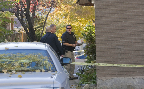 Paul Fraughton | Salt Lake Tribune Police officers investigate the scene of a shooting at an apartment on the 2300 block of Green Street in Sugar House.  Tuesday, October 30, 2012