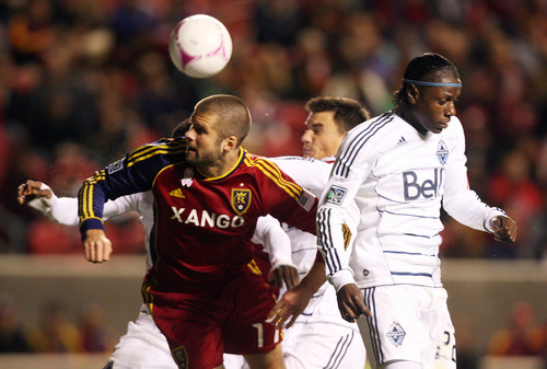 Real Salt Lake defender Chris Wingert (17) gets a head on a corner kick during an MLS soccer match on Saturday, Oct. 27, 2012, at Rio Tinto Stadium in Sandy. RSL and the Whitecaps played to a 0-0 draw. (AP Photo/The Salt Lake Tribune, Kim Raff )