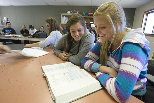 Paul Fraughton | The Salt Lake Tribune Taly Polukoff, right, Katy Greene, and Emily Leavens study physics in a classroom at the Winter Sports School at Utah Olympic Park.   Wednesday, October 10, 2012