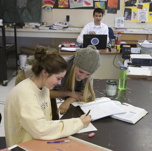 Paul Fraughton | The Salt Lake Tribune Rachel Jakob, left, and Cheech Minniear work in their physics class at the Winter Sports School at Utah Olympic Park near Kimball Junction. The class is taught by Alex Burlacu, rear.    Wednesday, October 10, 2012