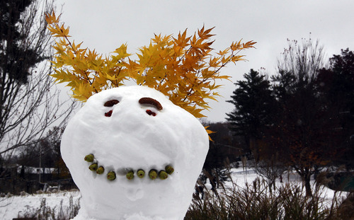 A snowman adorned with fall foilage looks over the campus at Appalachian State University in Boone, N.C. Tuesday Oct. 30, 2012. The North Carolina mountains got a taste of winter as superstorm Sandy brought high winds, freezing temperatures and several inches of snow to the mountains. (AP Photo/The News & Observer, Chuck Liddy) MANDATORY CREDIT
