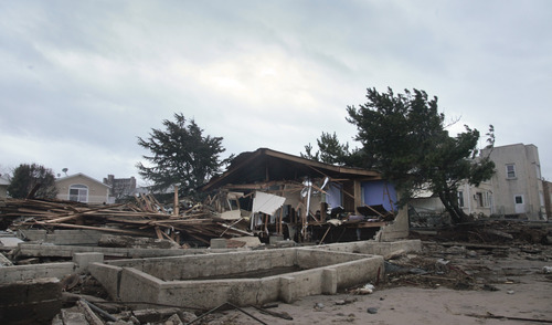 A beachfront house is completely destroyed in the aftermath of yesterday's surge from superstorm Sandy, Tuesday, Oct. 30, 2012, in Coney Island's Sea Gate community in New York. (AP Photo/Bebeto Matthews)