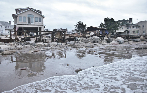 A beachfront house is damaged in the aftermath of yesterday's surge from superstorm Sandy, Tuesday, Oct. 30, 2012, in Coney Island's Sea Gate community in New York. (AP Photo/Bebeto Matthews)