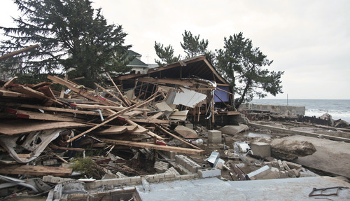 A beachfront house is completely destroyed in the aftermath of a superstorm Sandy, Tuesday, Oct. 30, 2012, in Coney Island's Sea Gate community in New York. (AP Photo/Bebeto Matthews)