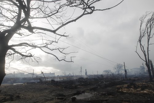 A landscape of destroyed homes is at Breezy Point, in the New York City borough of Queens Tuesday, Oct. 30, 2012 in the aftermath of superstorm Sandy. The fire destroyed between 80 and 100 houses Monday night in the flooded neighborhood. (AP Photo/Frank Franklin II)