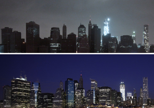 This combination of photos shows above, lower Manhattan dark after the hybrid storm Sandy on Monday, Oct. 29, 2012, and below a fully lit skyline on Jan. 6, 2012, both seen from the Brooklyn borough of New York. In an attempt to lessen damage from saltwater to the subway system and the electrical network beneath the city's financial district, New York City's main utility cut power to about 6,500 customers in lower Manhattan. But a far wider swath of the city was hit with blackouts caused by flooding and transformer explosions. (AP Photo)