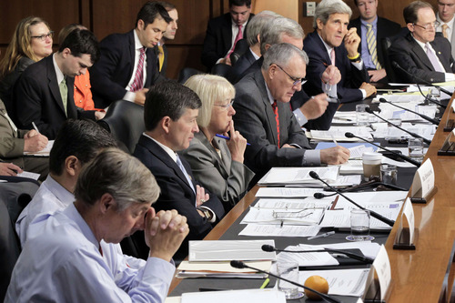 FILE - In this Sept. 13, 2011 file photo shows the Joint Select Committee on Deficit Reduction, led by co-chairs Rep. Jeb Hensarling, R-Texas, and Sen. Patty Murray, D-Wash., meeting on Capitol Hill in Washington to hear testimony about the national debt from the Congressional budget director. Just about everybody agrees Washington is a mess. But who can fix it? After two years of strife and stalemate between Obama and congressional Republicans, more voters trust Romney than Obama to break through the gridlock, an Associated Press-GfK poll shows. Romney's message _ a vote for Obama is a vote for more impasse _ seems to be getting through. Supercommittee members from left are Rep. Fred Upton, R-Mich., Rep. Xavier Becerra, D-Calif., Hensarling, Murray, Senate Minority Whip Jon Kyl of Ariz., Senate Finance Committee Chairman Sen. Max Baucus, D-Mont., Sen. Rob Portman, R-Ohio, Sen. John Kerry, D-Mass., and Sen. Pat Toomey, R-Pa.  (AP Photo/J. Scott Applewhite, file)