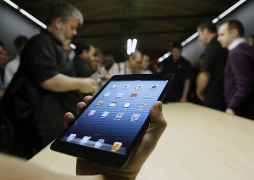 The iPad Mini is shown in San Jose, Calif., Tuesday, Oct.  23, 2012.  Apple Inc. is refusing to compete on price with its rivals in the tablet market,  it's pricing its new, smaller iPad well above the competition. On Tuesday, the company revealed the iPad Mini, with a screen that's about two-thirds the size of the full-size model, and said it will cost $329 and up. (AP Photo/Marcio Jose Sanchez, File)