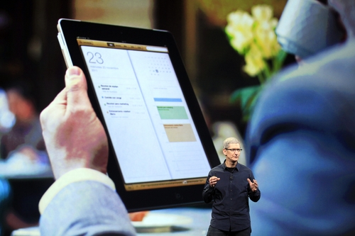 Apple CEO Tim Cook speaks during an event in San Francisco, Wednesday, March 7, 2012, to reveal a new iPad model.  (AP Photo/Jeff Chiu)