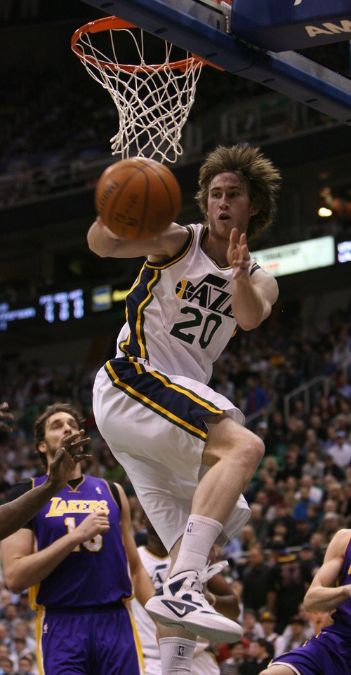 Steve Griffin  |  The Salt Lake Tribune  Utah's Gordon Hayward passes from under the basket during first half action of the Jazz versus Lakers game at EnergySlutions Arena in Salt Lake City, Utah  Wednesday, January 11, 2012.