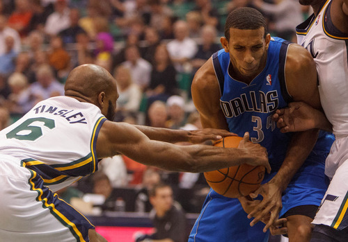 Trent Nelson  |  The Salt Lake Tribune Utah Jazz guard Jamaal Tinsley (6) steals the ball from Dallas's Brandan Wright as the Utah Jazz host the Dallas Mavericks, NBA basketball, Wednesday October 31, 2012 at EnergySolutions Arena in Salt Lake City, Utah.