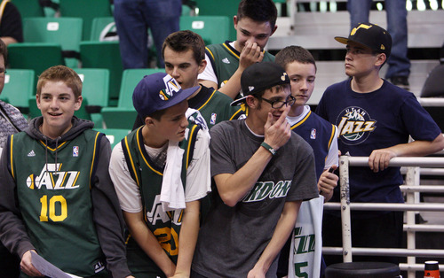 Steve Griffin | The Salt Lake Tribune   Jazz fans wait for players to come out of the locker room for shoot-around prior to the tip-off of opener against the Dallas Mavericks at EnergySolutions Arena  in Salt Lake City on Wednesday, Oct. 31, 2012.