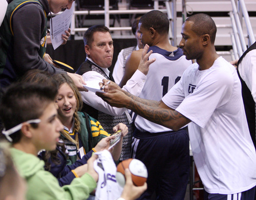 Steve Griffin | The Salt Lake Tribune   Jazz guard Mo Williams signs autographs after he warmed up prior to the tip of the Jazz versus Mavericks game at EnergySolutions Arena  in Salt Lake City, Utah Wednesday October 31, 2012.