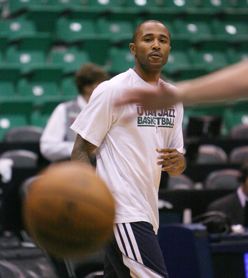 Steve Griffin | The Salt Lake Tribune   Jazz guard Mo Williams shoots three pointers as he warms up prior to the tip of the Jazz versus Mavericks game at EnergySolutions Arena  in Salt Lake City, Utah Wednesday October 31, 2012.