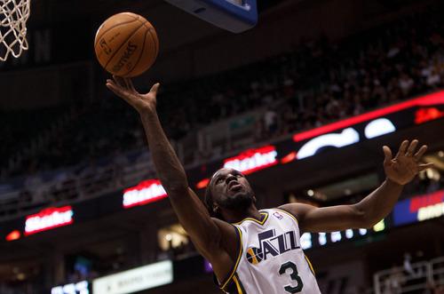 Trent Nelson  |  The Salt Lake Tribune Utah Jazz's Demarre Carroll (3) shoots the ball as the Utah Jazz host the Portland Trailblazers in preseason NBA basketball Thursday October 25, 2012 at EnergySolutions Arena in Salt Lake City, Utah.