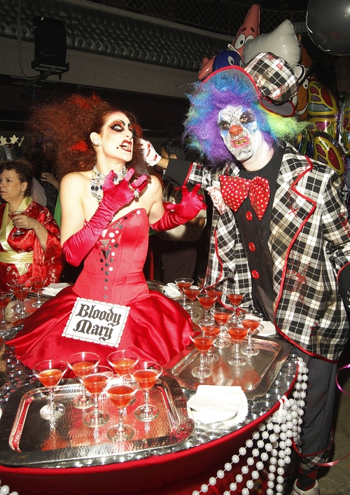 Bloody Mary and a crazy clown are on the town for a nightclub's Halloween party in San Francisco. (Tony Avelar/ AP Images for Party City)