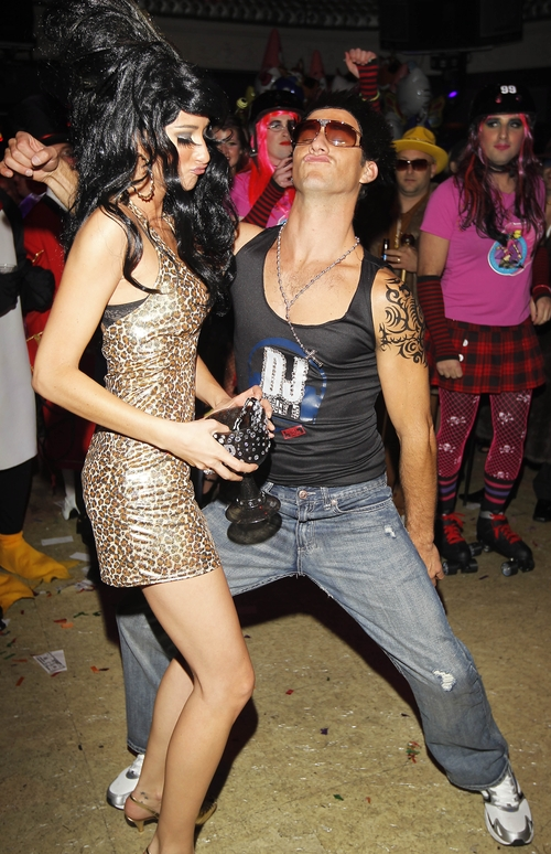 Partygoers dressed as Snooki and Pauly D attend this nightclub Halloween Bash in San Francisco. (Tony Avelar/AP Images for Party City)