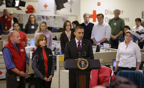 President Barack Obama speaks during the his visit to the Disaster Operation Center of the Red Cross National Headquarter to discuss superstorm Sandy, Tuesday, Oct. 30, 2012, in Washington. From left are, Red Cross Senior Vice President of Disaster Services Charles Shimanski, Red Cross President and CEO Gail J. McGovern, and the president.  (AP Photo/Pablo Martinez Monsivais)
