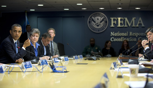 President Barack Obama, accompanied by members of his Cabinet, speaks at the Federal Emergency Management Agency (FEMA) Headquarters in Washington, Wednesday, Oct. 31, 2012, to discuss the recent superstorm Sandy. From left are, the president, Homeland Security Secretary Janet Napolitano, Defense Secretary Leon Panetta, and Housing and Urban Development (HUD) Secretary Shaun Donovan. White House Chief of Staff Jacob Lew is at right.  (AP Photo/Carolyn Kaster)