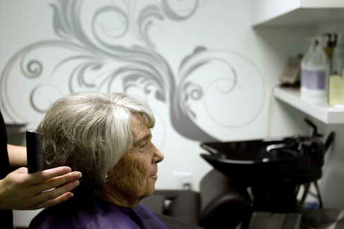 Kim Raff | The Salt Lake Tribune (left) Brittany Sawatzki, owner of Tangalez (cq), cuts Beth Koch's hair during the grand opening of Image Studios in Sandy, Utah on September 29, 2012. Image Studios is a new-concept salon where it's hair and body-care professionals run their own businesses out of the studios instead of leasing the space. They have several locations in the Salt Lake Valley