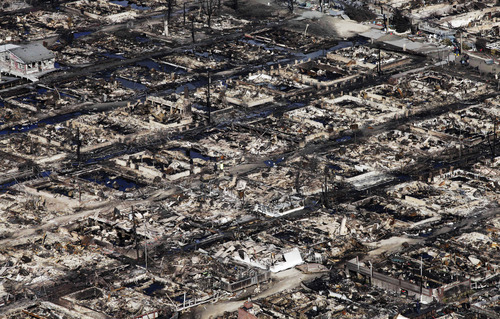 This aerial photo shows the Breezy Point neighborhood, in New York, Wednesday, Oct. 31, 2012, where more than 50 homes were burned to the ground Monday night as a result of superstorm Sandy.  Sandy, the storm that made landfall Monday, caused multiple fatalities, halted mass transit and cut power to more than 6 million homes and businesses. (AP Photo/Mark Lennihan)