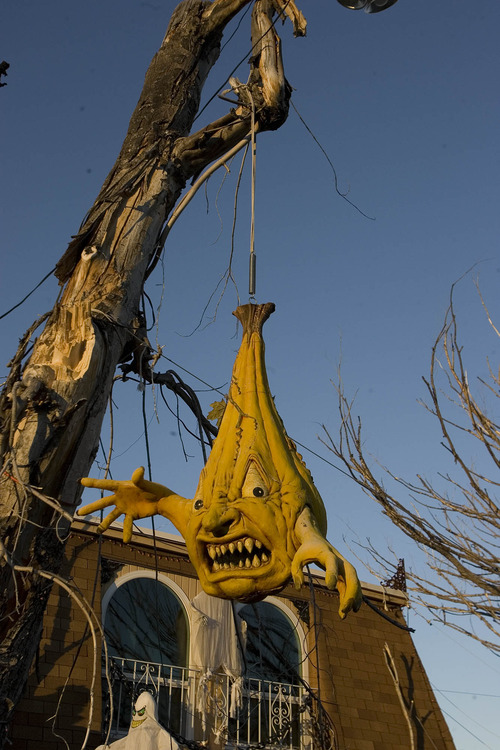 Paul Fraughton | The Salt Lake Tribune An angry ghoul hangs from a tree in the front yard of the  home of James Gamble.The home is transformed into a mad scientist's laboratory on the inside with a yard full of goblins and ghouls on the outside.