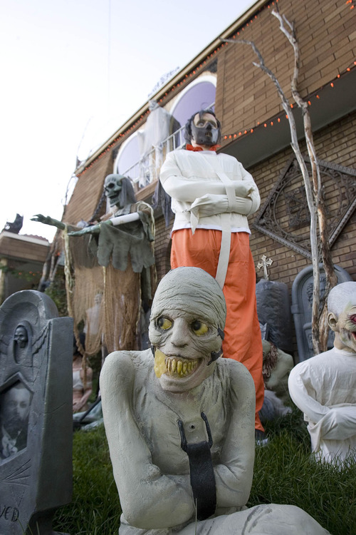 Paul Fraughton | The Salt Lake Tribune The  West Valley City home of James Gamble is transformed into a mad scientist's laboratory on the inside with a yard full of goblins and ghouls on the outside.