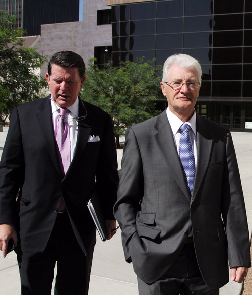 Christopher Tappin, right, and his lawyer Dan Cogdell, leave federal court Thursday, Nov. 1, 2012 in El Paso, Texas. The 66-year-old British businessman pleaded guilty to trying to export defense materials Thursday in a deal that would carry nearly three years in prison but could allow him to serve much of that time in his native United Kingdom. (AP Photo/Juan Carlos Llorca)